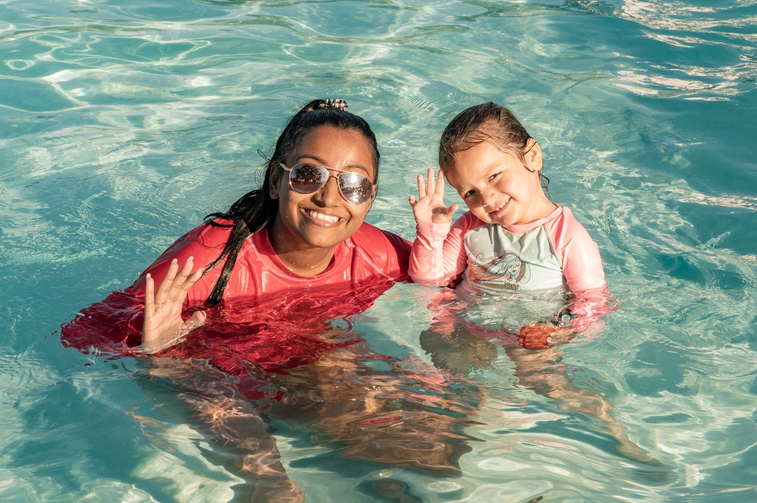 Swim instructor and child during swim lessons