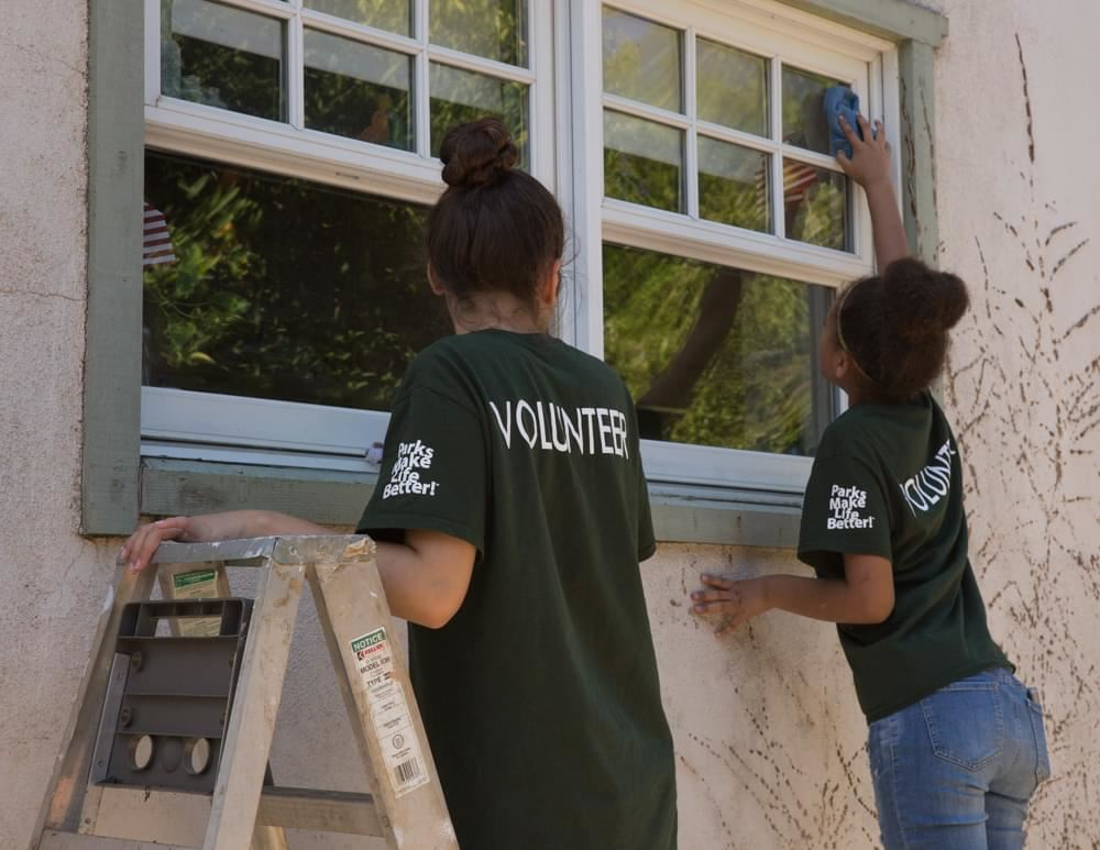 Volunteers painting windows